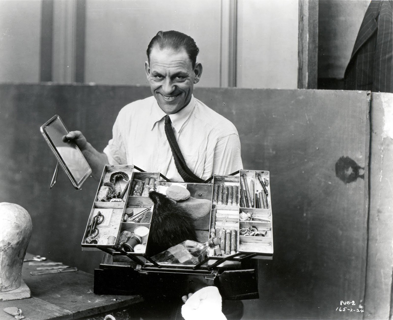 Lon Chaney, star of many 1920s horror movies, and his makeup box, 1925