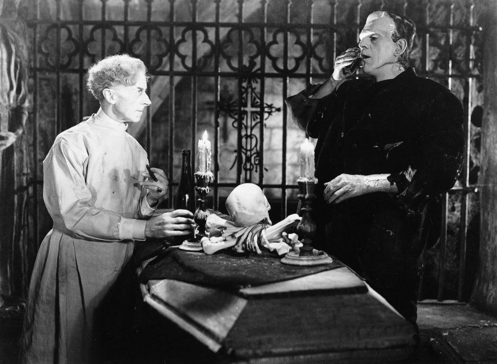 Dr. Pretorius (Ernest Thesiger) and the Monster (Boris Karloff)