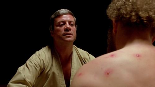 Dr. Hal Raglan (Oliver Reed) treats his patient Michael (Gary McKeehan) using 'psychoplasmics' (The Brood 1979)
